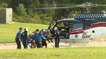 Authorities say a boy stood up and silently attacked a 14-year-old girl at an Oklahoma high school on the first day of classes; the victim was airlifted to hospital.