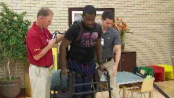 Navy veteran Laquan Taylor was able to stand and walk again thanks to a life-changing exoskeleton suit.