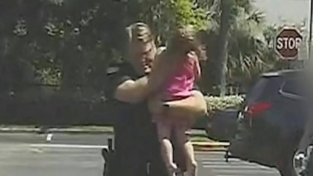 Dramatic video shows moment Florida cop saves little girl from hot car after she was trapped inside for 12 hours