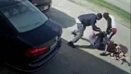 A shocking and graphic video showed a group of thieves attempting to steal $75,000 of cash from a woman's purse in Houston, Texas.