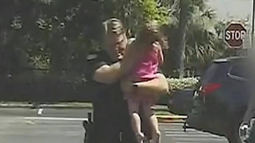 Florida police video shows Deputy Bill Dunn rescuing a three-year-old girl.