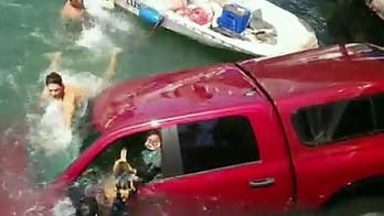 Quick-thinking rescuers jump into the water after a pickup truck drives through a guardrail and into the water in Long Beach, California.
