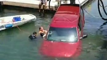Raw video: Truck lands in the water after plowing through a guardrail in Long Beach, California. Quick-thinking good Samarians move to save the occupants.