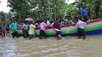 Rescue efforts continue as solders and rescue crews try to help people stranded by heavy flooding following days of incessant rain in southern India's Kerala state.