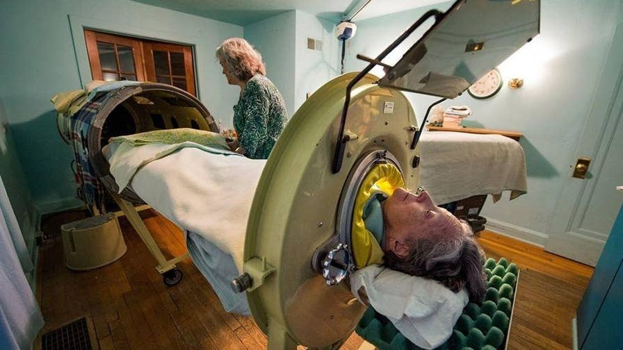 """82-year-old polio survivor Mona Randolph uses one of only three """"iron lungs"""" known to still be in use in the U.S. The iron lung, which was invented in 1920s, was often used on polio patients who were unable to breathe after the virus paralyzed muscle groups in the chest. Six nights a week, Randolph sleeps up to her neck in a noisy, airtight, 75-year-old iron tube."""