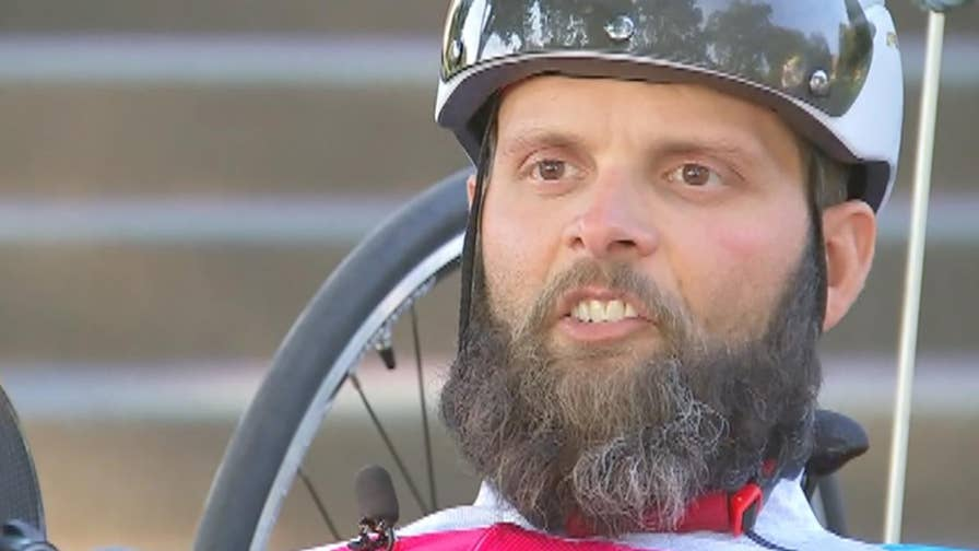 Paralyzed US army veteran Ricky Raley hand-cycles 1,500 miles to raise mental health awareness.