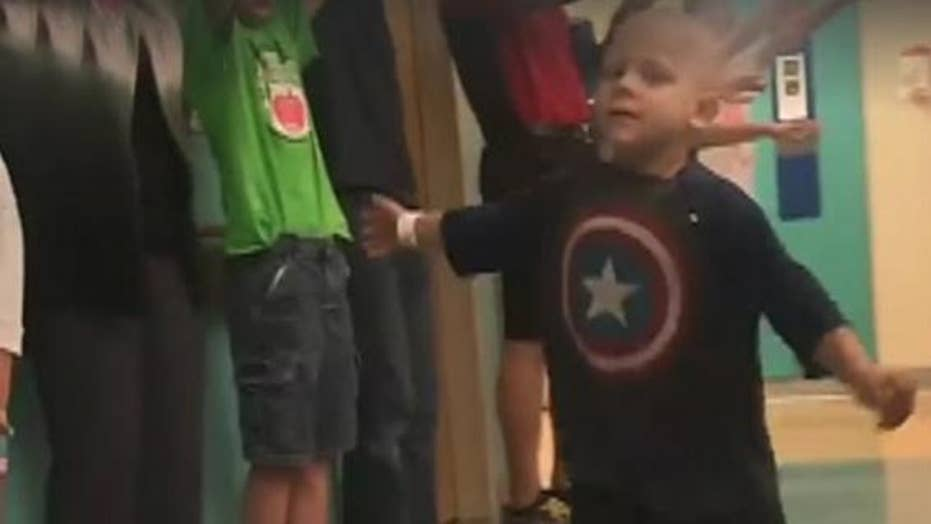 Child cheered on after completing last round of chemo