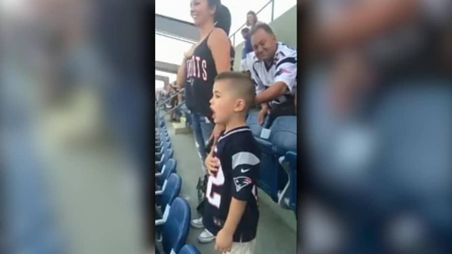 Young boy sings the national anthem