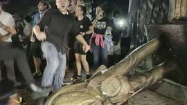 "The destruction of a Confederate statue in the heart of North Carolina's flagship university by hundreds of protesters on Monday night was ""unlawful and dangerous,"" university leaders said."