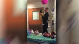 The father of a young girl with leukemia shared a touching moment with the youngster -- with the results caught on camera.