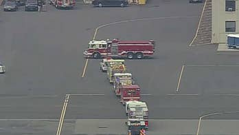 Reports: London-bound jet that blew two tires taking off at New Jersey's Teterboro Airport diverted to Massachusetts for an emergency landing.