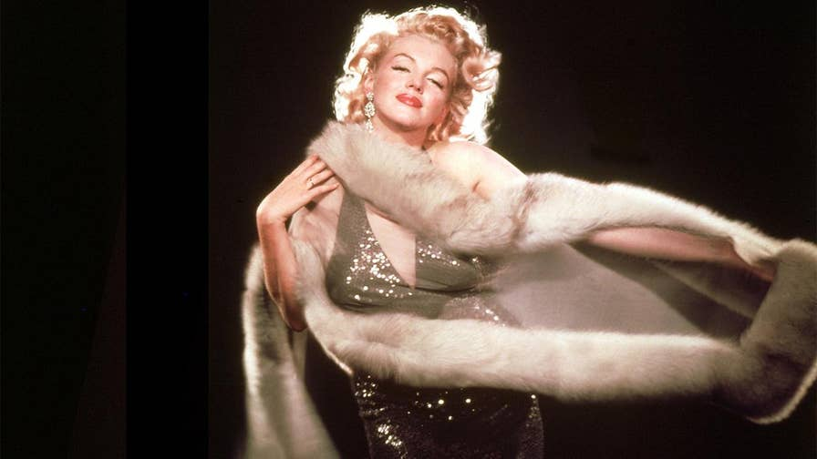 Marilyn Monroe filmed a racy scene to please audiences, book claims.
