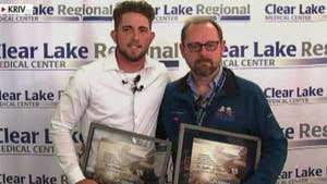 Two men raced through flood waters to assist teenager who needed emergency surgery.