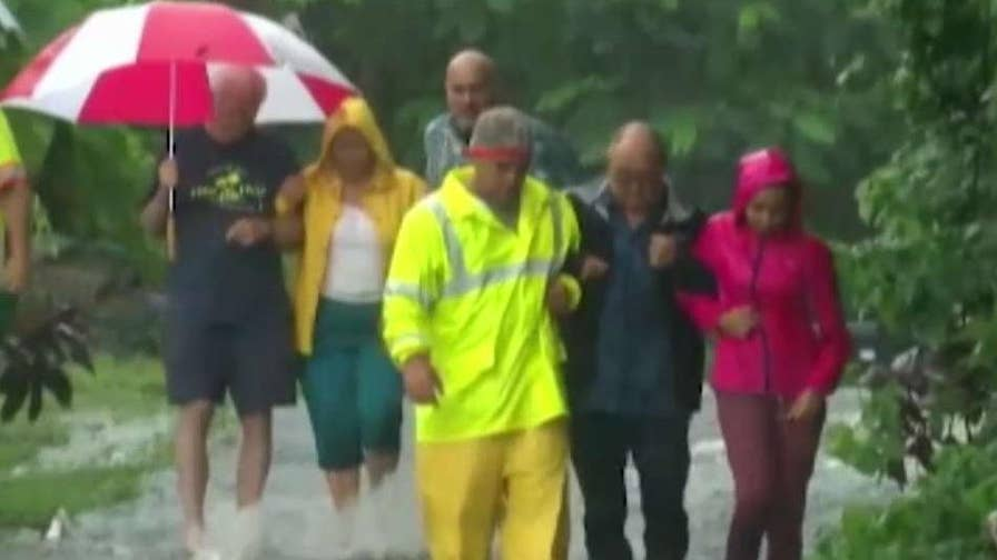 Category two hurricane batters the Hawaiian Islands with high winds and torrential rain, causing mudslides and flash flooding; Adam Housley reports.