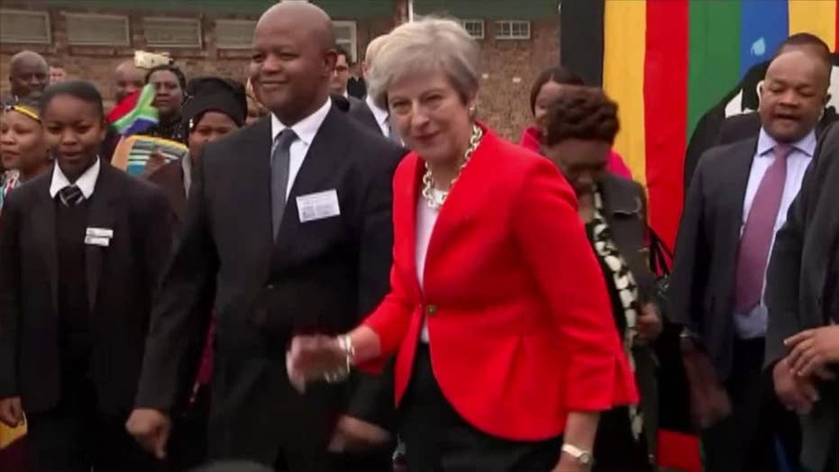 Watch: British PM Theresa May dance in Cape Town