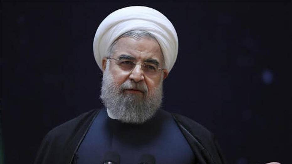 Iran's parliament rebukes Rouhani over economic woes