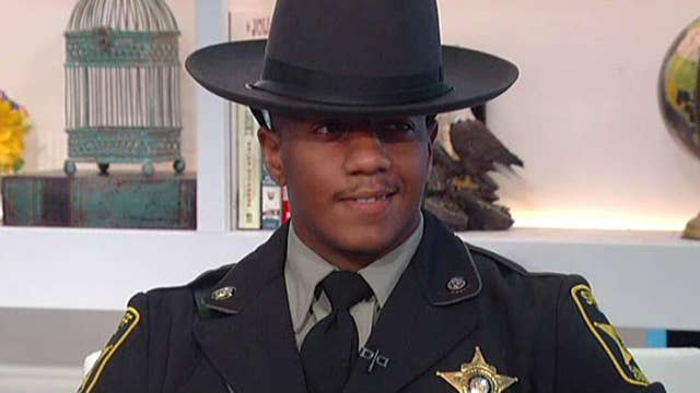 Image result for Security Guard Pardoned on Gun Charge Achieves Dream of Becoming a Cop