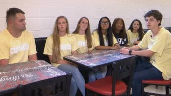 Student council members at Boiling Springs High School in South Carolina invite fellow classmate who often eats alone to their lunch table.