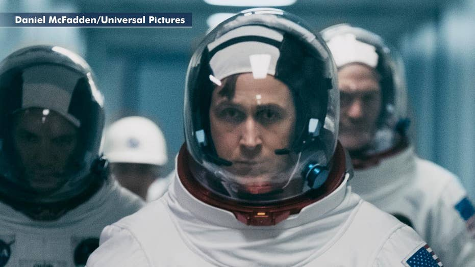 Film on space race omits US flag from moon landing scene