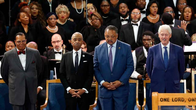 Farrakhan seated next to Clinton at Aretha Franklin service