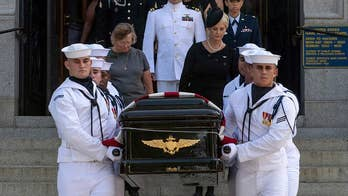 McCain is buried next to his friend Admiral Chuck Larson. Lucas Tomlinson has the story.
