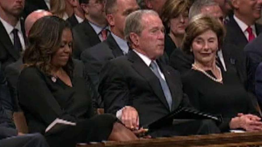 The former president sneaked the former first lady a piece of candy during Senator John McCain's funeral in a sweet display of bipartisanship.