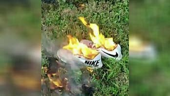 One former Nike consumer burns their shoes in protest.