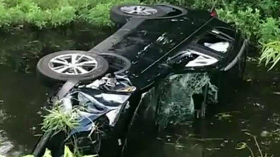 Siblings rescue family from overturned SUV