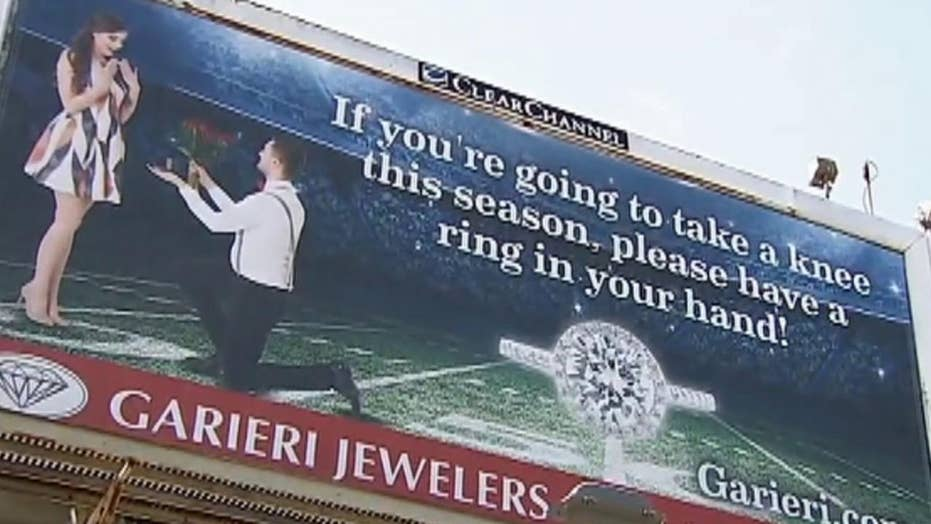 Jewelry store's 'kneeling' billboard draws backlash