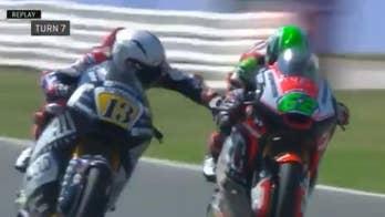 Motorcycle racer banned after grabbing competitor handbrake
