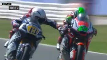 Motorcycle racer banned and fired after grabbing competitor's handbrake