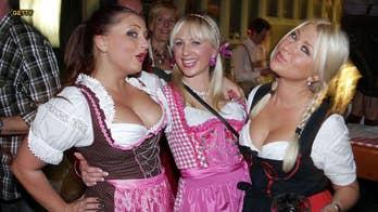 Female Oktoberfest tourists slammed for 'porno dresses'