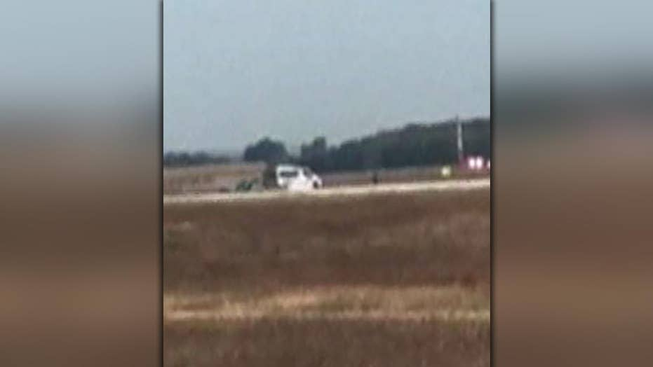 Man crashes onto French airport runway