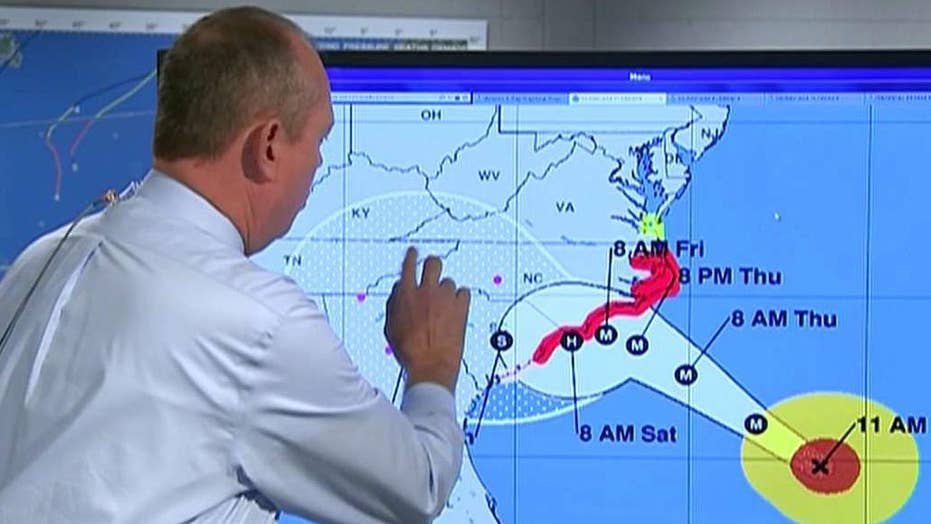 Florence expected to slow down, scrape along Carolina coast