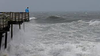 Police enforce a mandatory evacuation in Wrightsville Beach, North Carolina. Jonathan Serrie reports.