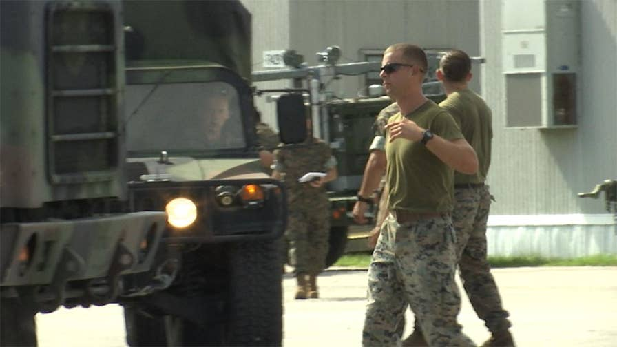The largest Marine Corps base on the East Coast opened its gates to anyone with Department of Defense IDs, as Florence takes aim at the Carolinas.