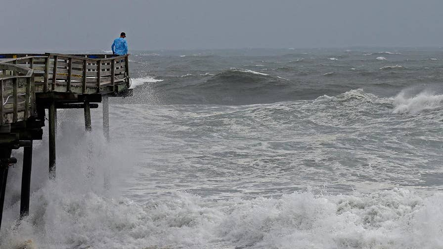 Police enforce a mandatory evacuation in Wrightsville Beach, North Carolina. Jonathan Serrie reports.
