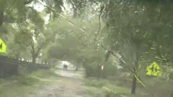 Downed trees, branches on the hurricane-lashed streets of Wilmington, North Carolina.