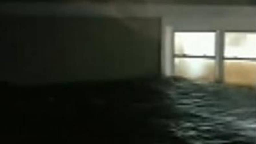 Floodwaters rise above ground floor of house in Belhaven, North Carolina as Hurricane Florence hits the state.