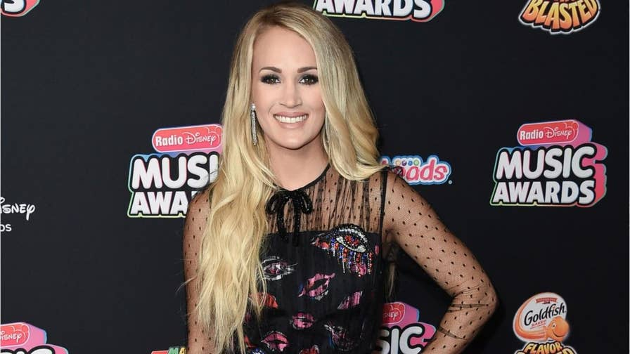 """Carrie Underwood tells Jimmy Fallon on """"The Tonight Show"""" that a viral infection is what caused a recent cancellation of her shows in the UK."""