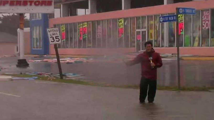 Slow-moving storm batters North Carolina city with wind and rain; Leland Vittert reports.