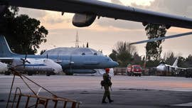 Russia's military on Tuesday said one of its aircraft with 15 people on board was shot down by Syrian government missiles and blamed the Israeli Air Force for pushing its Il-20 jet into the line of fire of Syrian missiles.