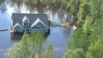 Rescue operations continue in communities swamped by flooding from Hurricane Florence; chief correspondent Jonathan Hunt reports from over Pender County, North Carolina.