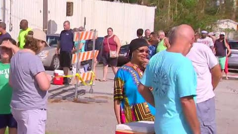 Florence victims line up for ice in Wilmington, NC