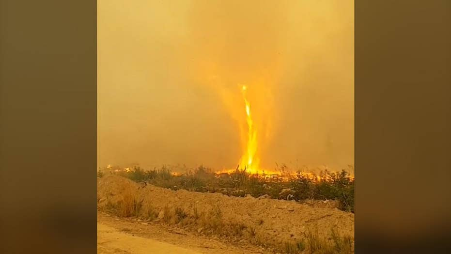 Incredible Video: 'Firenado' engulfs firefighter hose