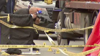 Raw video: Police investigate the scene where a woman was fatally struck by a flatbed tow truck, a man believed to be her son, then allegedly stabbed the truck driver.