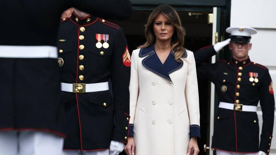 Melania Trump's pricey coat draws praise and questions