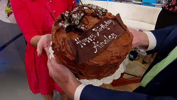 'Fox & Friends' co-host celebrated with cake and a surprise call.