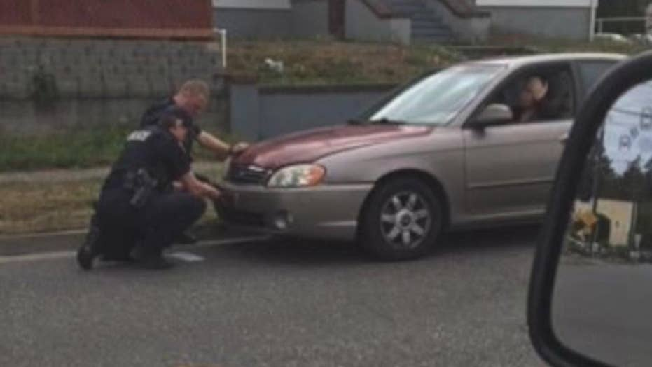 Officers help single mom change license plate