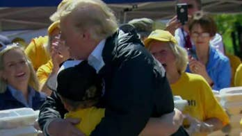 New Bern, North Carolina boy who hugged President Trump was lending a helping hand to Florence victims.